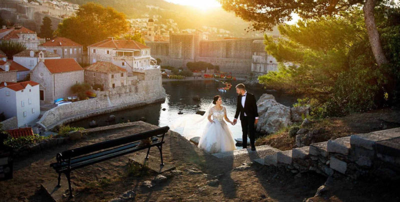 Bride and groom walking up steps in front Pile Gate in Dubrovnik,Croatia - Picture by Ciprian Biclineru