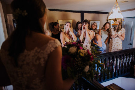 Ladies' reactions seeing bride in her dress for first time - Picture by Manon Pauffin Photography