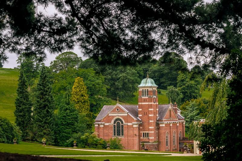 Hawkstone Hall through trees