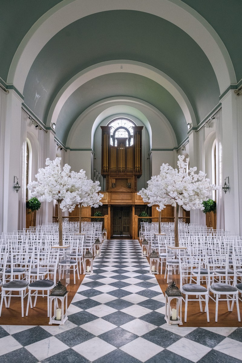 Wedding ceremony seating in The Chapel at Hawkstone Hall