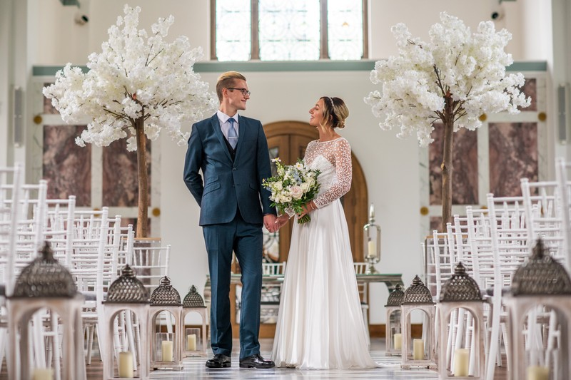 Bride and groom in The Chapel at Hawkstone Hall