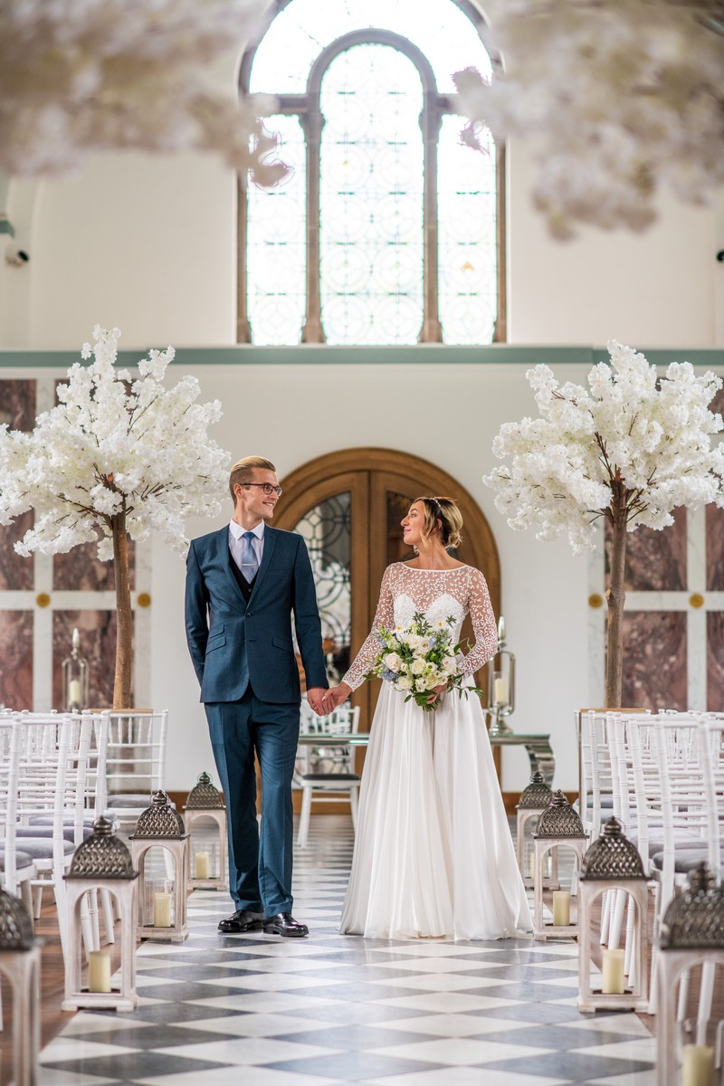 Bride and groom walking down the aisle in The Chapel at Hawkstone Hall