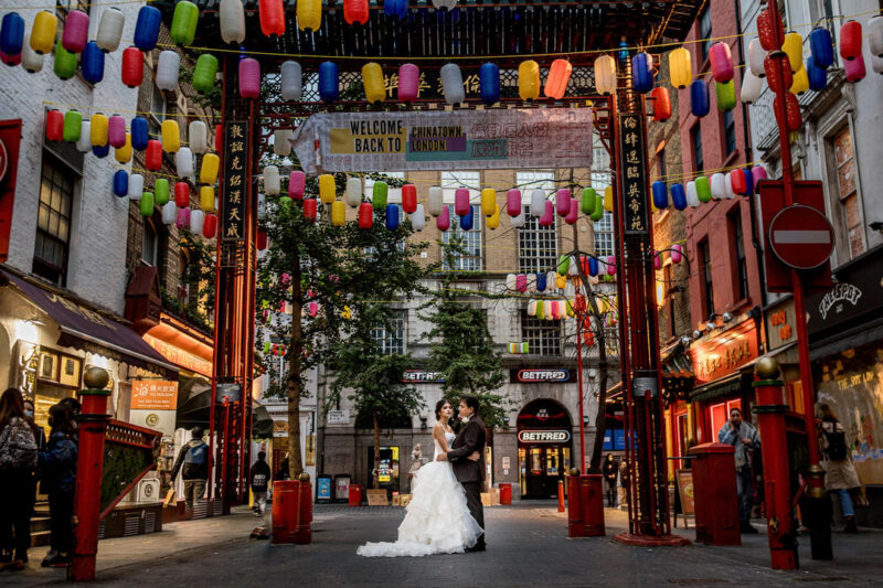 Bride and groom under lanterns in Chinatown, London - Picture by Rafe Abrook Photography