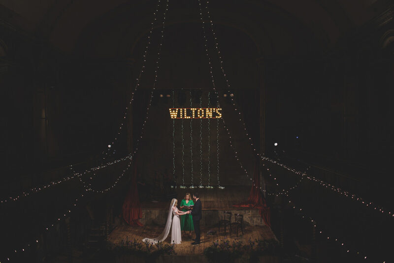 Wedding ceremony on stage at Wilton's Music Hall - Picture by Rik Pennington Photography