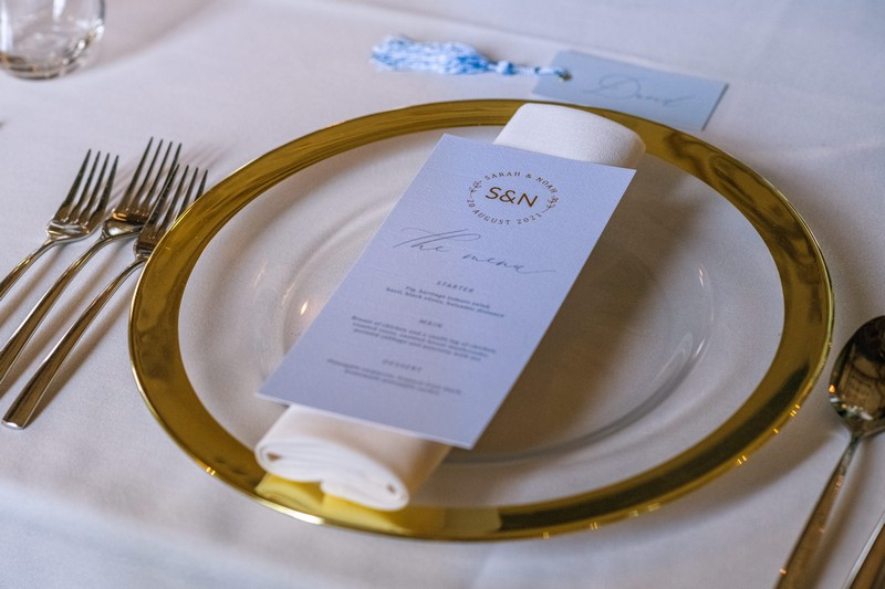 Wedding place setting with gold rimmed plate
