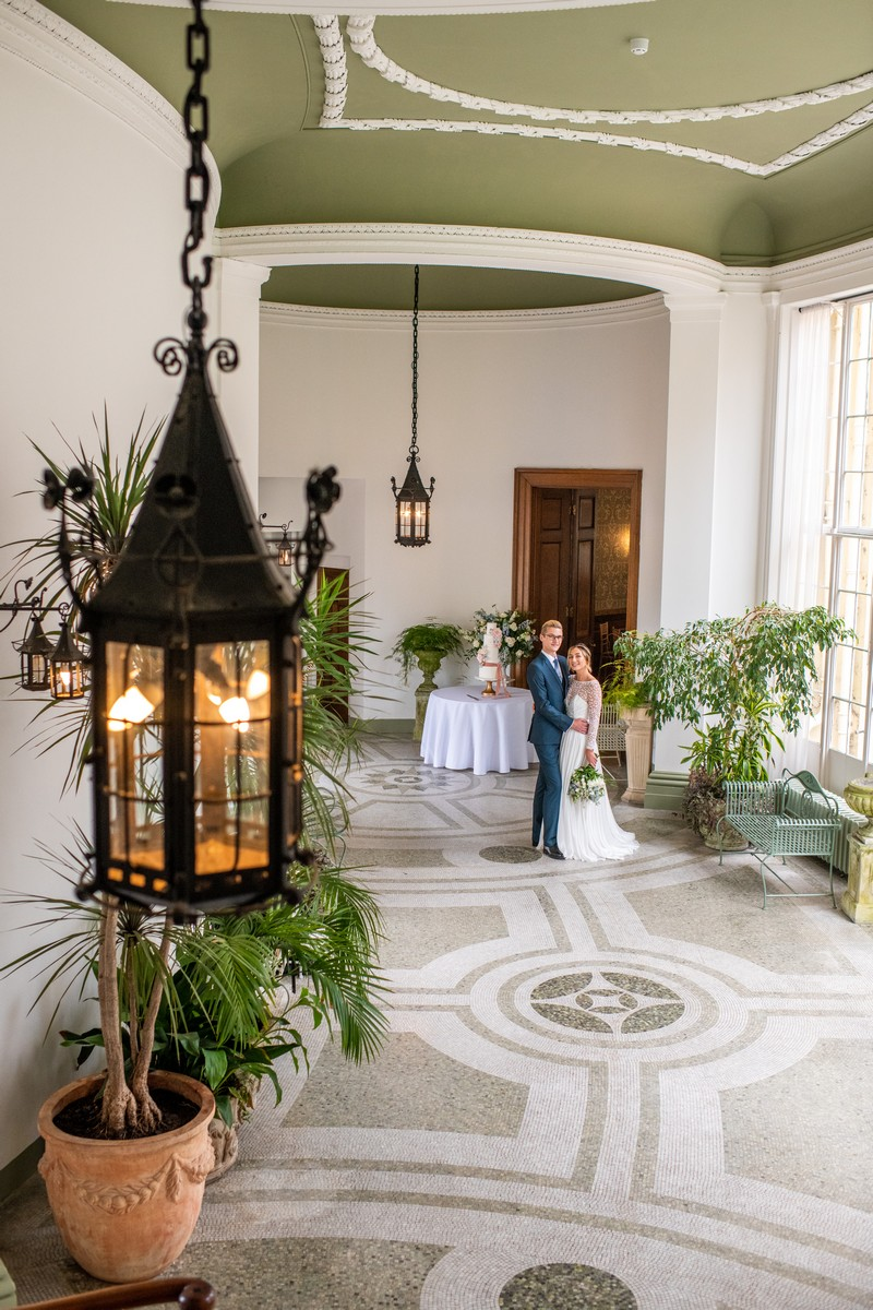 Bride and groom in The Winter Garden at Hawkstone Hall