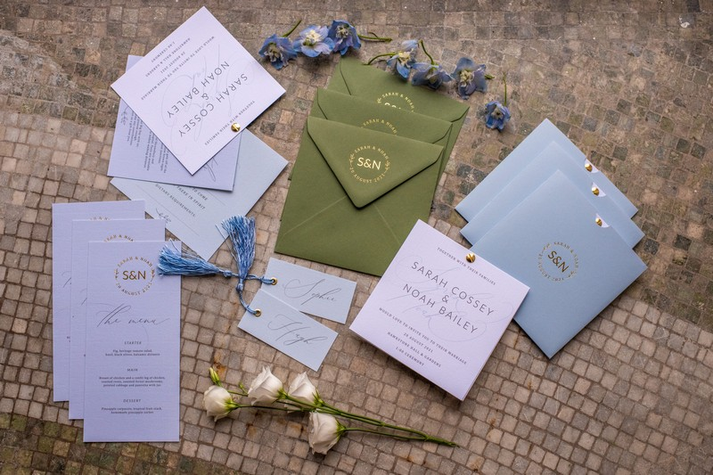 Pale blue, green and ivory wedding stationery