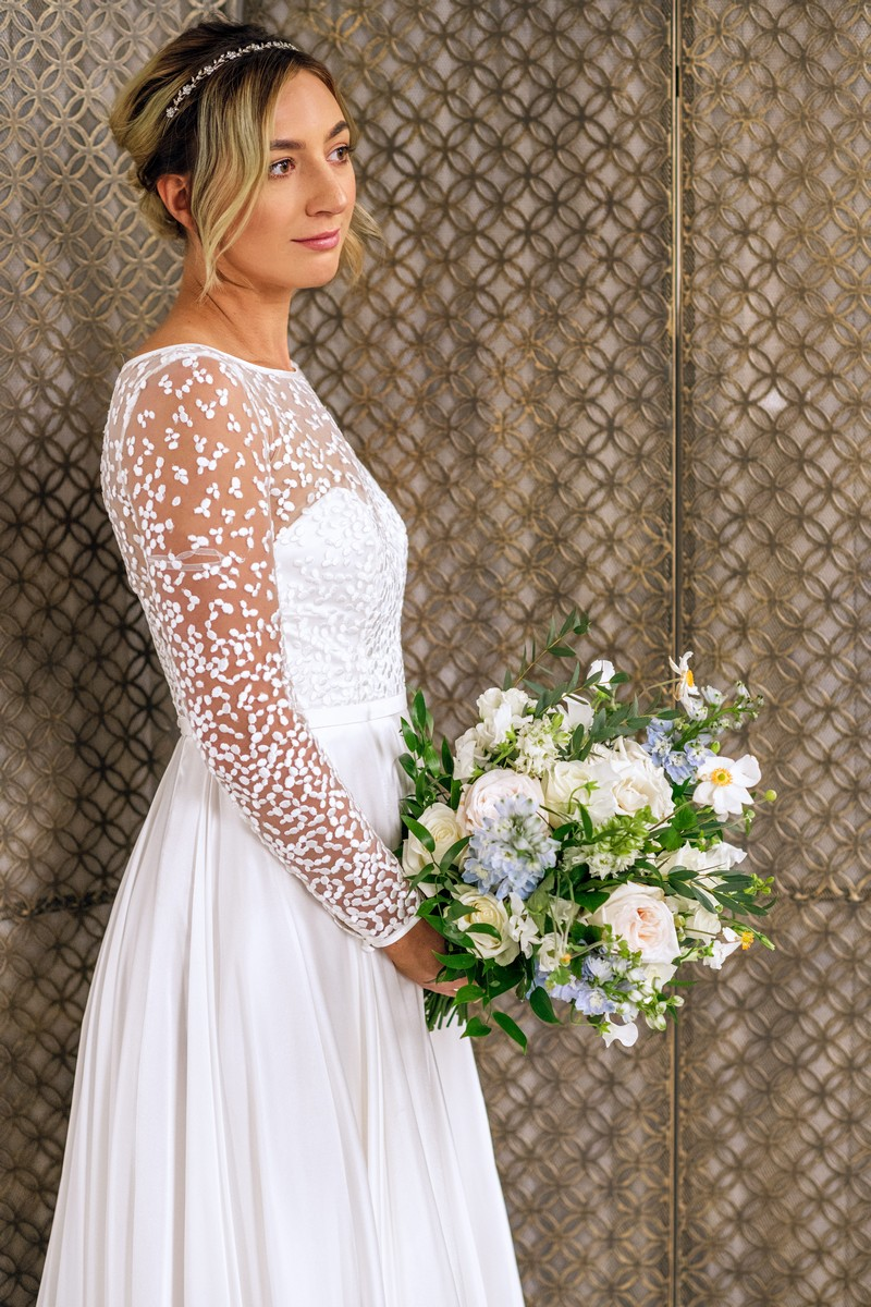 Bride wearing wedding dress with patterned sleeves