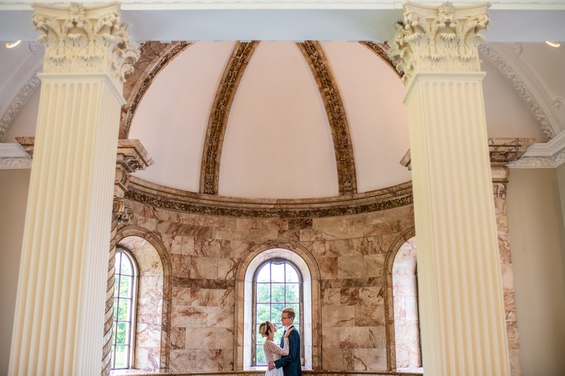 Bride and groom by window of The Tapestry Room at Hawkstone Hall