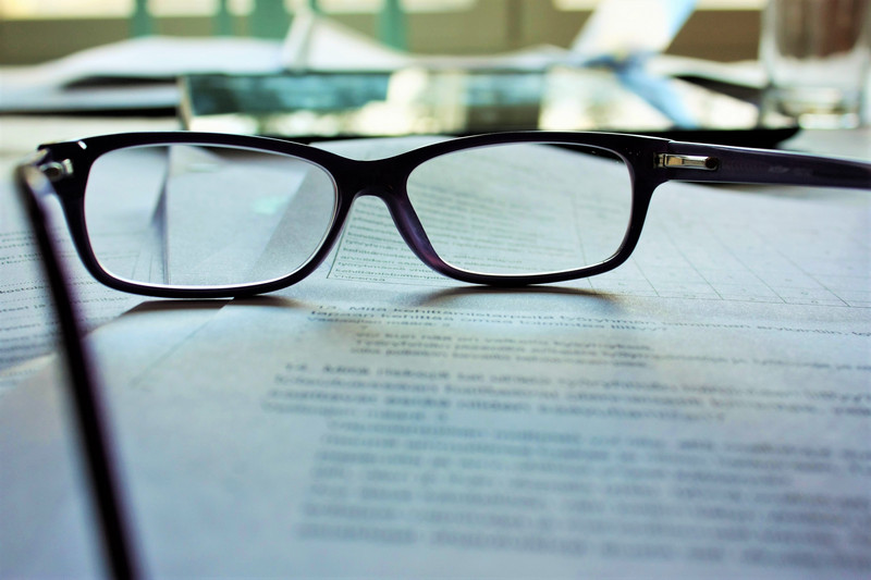 Pair of glasses on top of contract