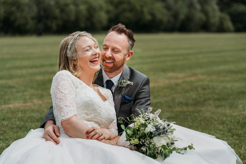 Happy bride and groom laughing together