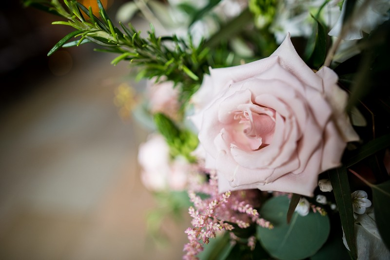 Pink rose and rosemary in wedding flowers