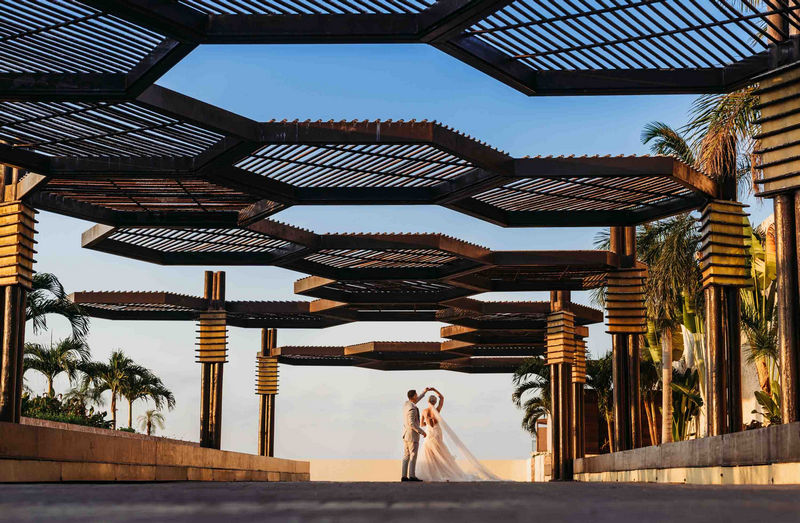 Groom twirls bride under hexagons outside Royalton Riviera hotel - Picture by Martin Cheung Photography