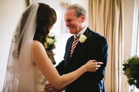 Father crying when he sees daughter in wedding dress - Picture by Kristian Leven Photography