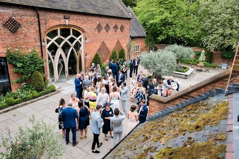 Wedding guests outside Shustoke Barn