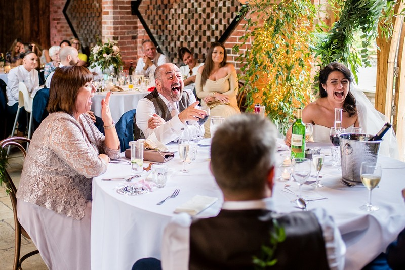Guests laughing at wedding speech
