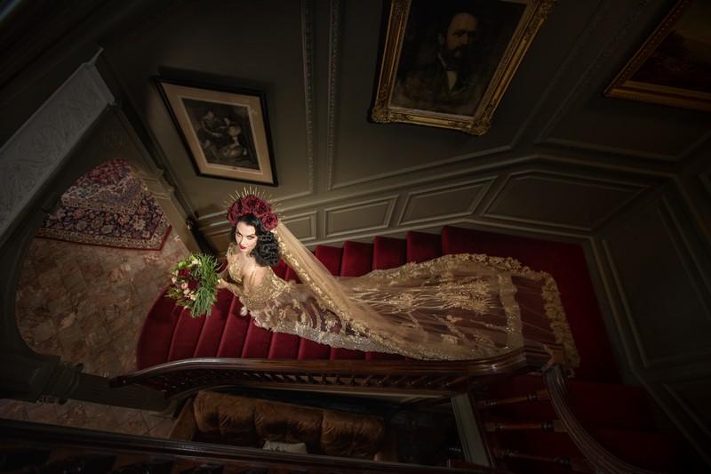 Bride walking down stairs at Thornton Manor