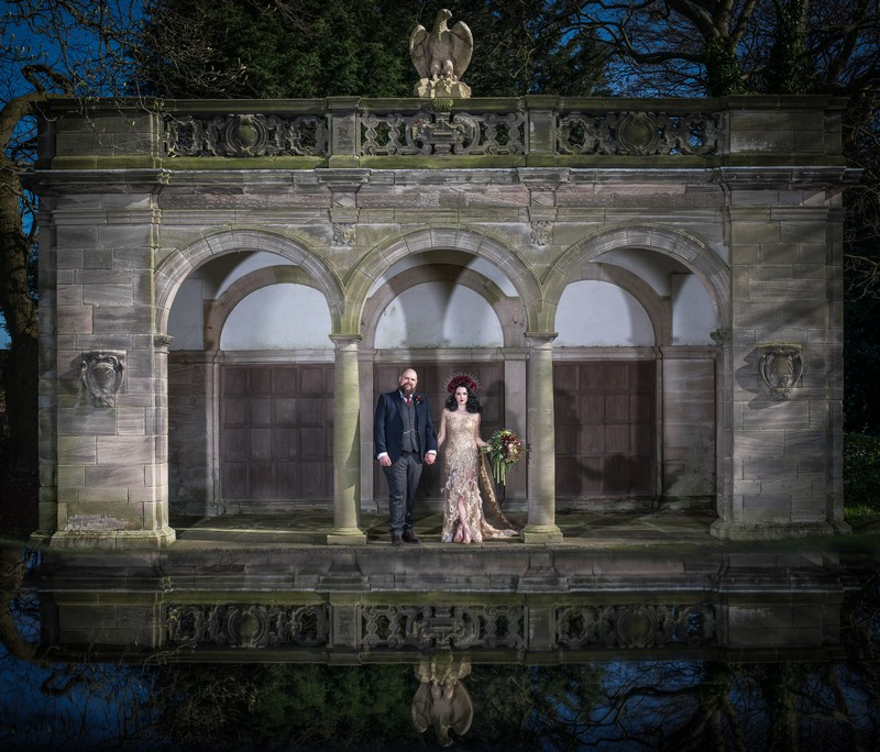 Bride and groom in grounds of Thornton Manor