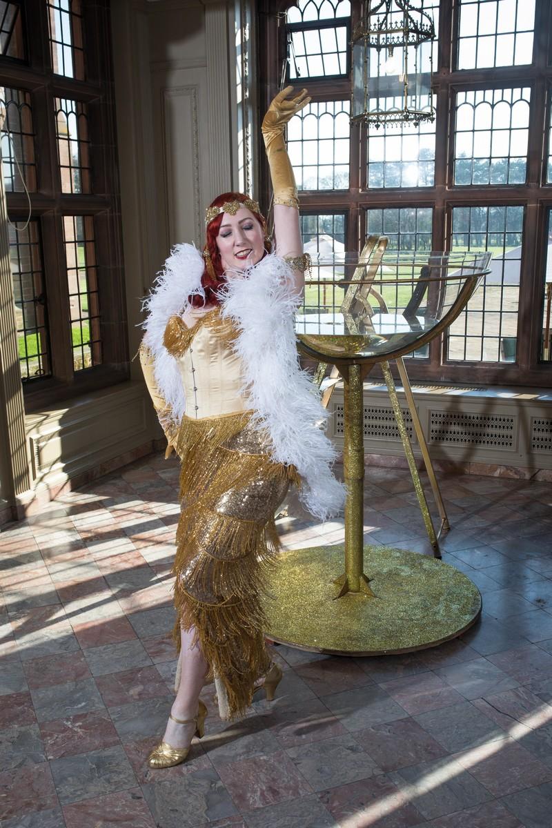 Burlesque performer at Gothic wedding