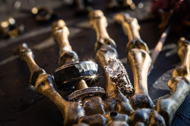 Wedding rings on skeleton hand