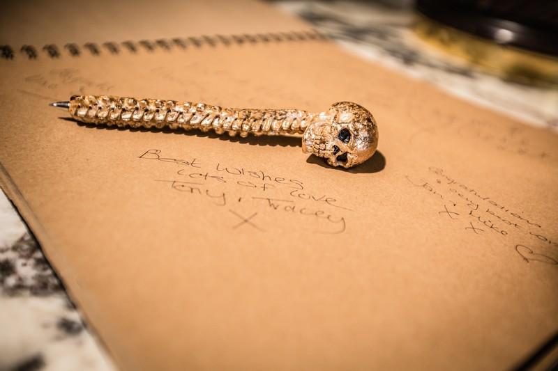 Skull pen on top of wedding guest book message