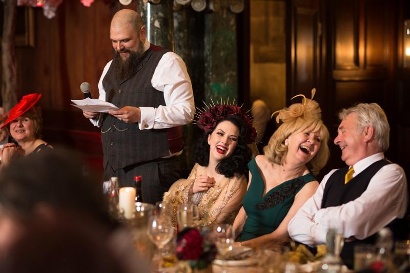 Laughing at groom wedding speech