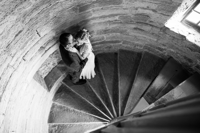 Couple on spiral stairwell