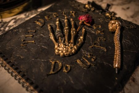 Gothic wedding guest book with skeleton hand on front