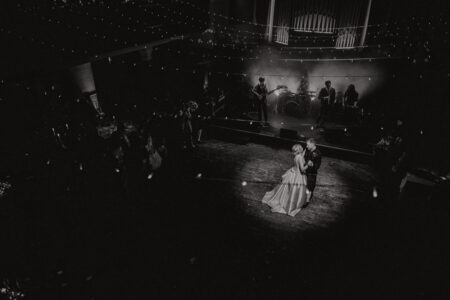 Bride and groom under spotlight on dance floor - Picture by Good Luck Wolf Photography