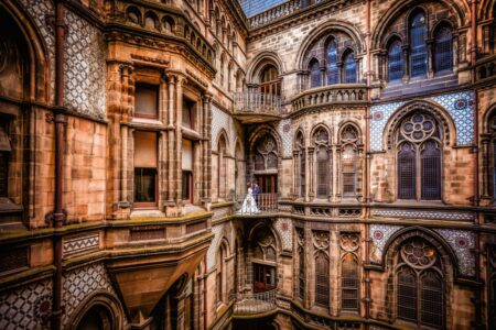 Bride and groom on balcony of Manchester Town Hall - Picture by Paul Baybut Photography