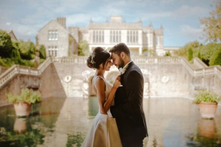 Bride and groom touching heads in front of Euridge Manor - Picture by Joab Smith