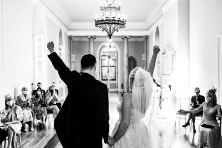 Bride and groom punching the air after wedding ceremony - Picture by Jonny Barratt Photography