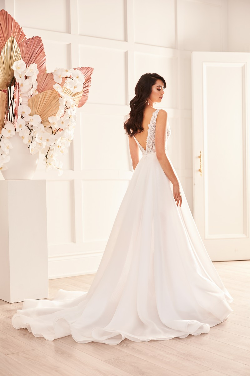 Back of Style 4959 wedding dress with overskirt from the Paloma Blanca Fall 2021 Bridal Collection