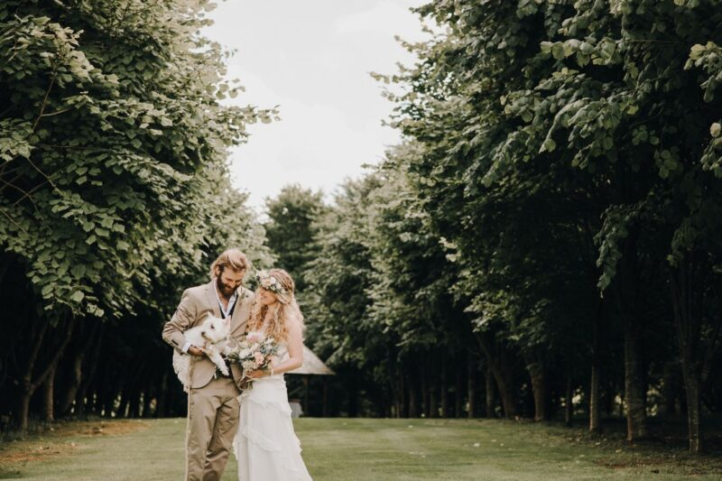 Bride and groom holding dog - Picture by Katie Goff Photography
