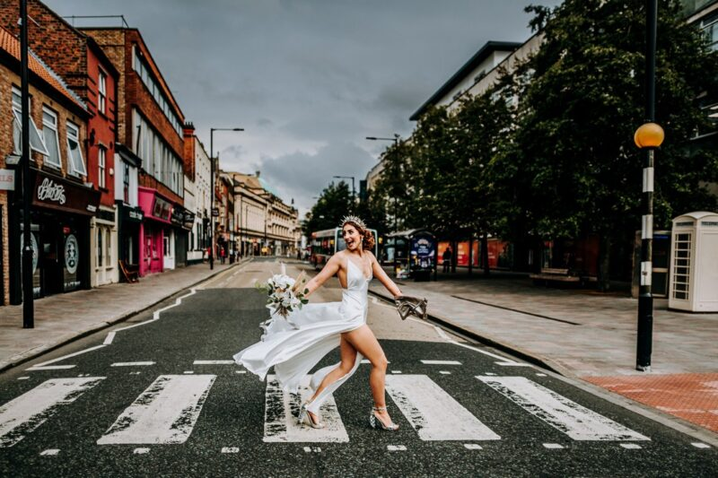 Bride walking across zebra crossing - Picture by M and G Wedding Photography