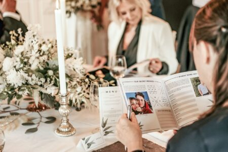 Wedding guest reading Love Story booklet from CherryTop Weddings