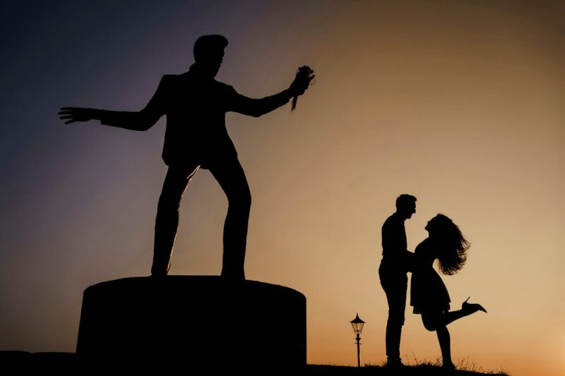 Silhouette of couple next to Elvis statue - Picture by Stephen Walker Photography