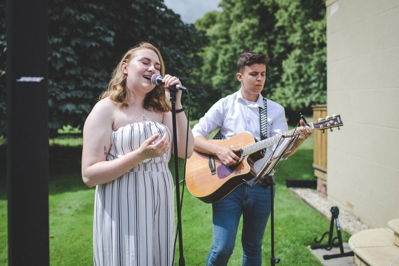 Acoustic duo providing outdoor wedding music