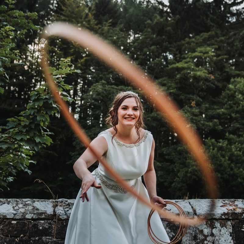 Bride throwing hoop at camera - Picture by David West Photography