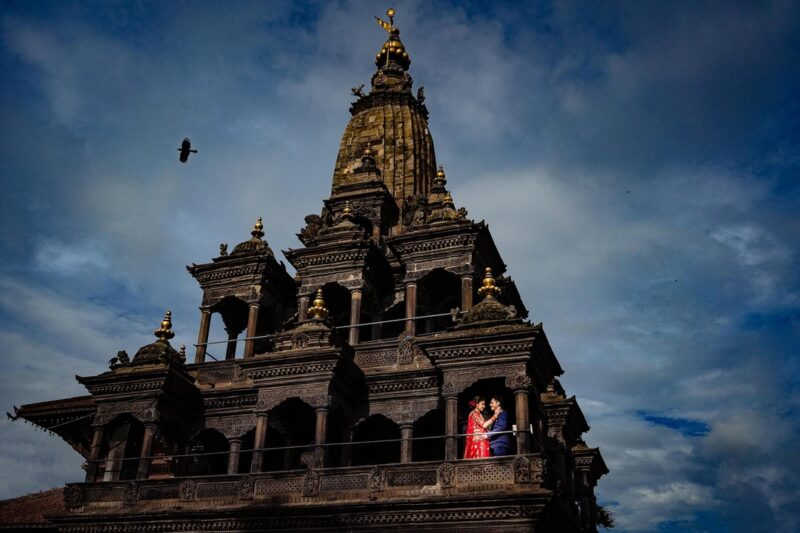 Bride and groom on Sri Krishna Mandir in Patan Durban Square - Picture by Soven Amatya Photography