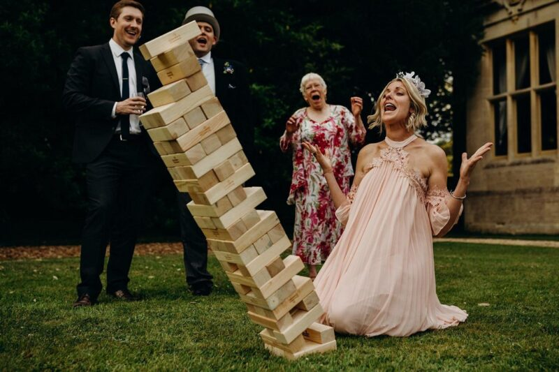 Bridesmaid on her knees shouting as Jenga tower topples over - Picture by Richard Skins Photography