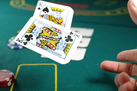 Playing cards being throw across table